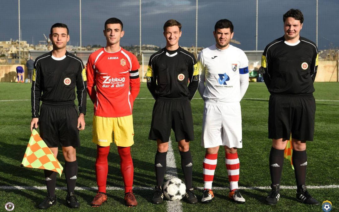 Holders earn qualification with two late goals