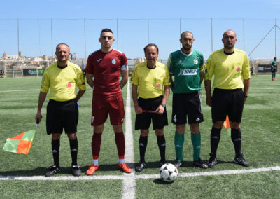 Team Captains with the match officials.